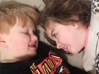 Isabelle Gregory, 8, who has mitochondrial disease, and her brother Issac, 10, who helps care for her